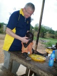 Former Rotary Club of Juba President Michael Elmquist with the children